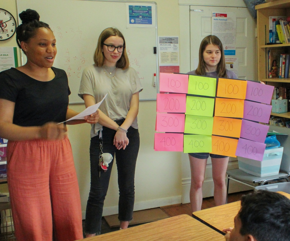 Tochi Okeke quizzes SnackChef scholars during a game of Nutrition Jeopardy.