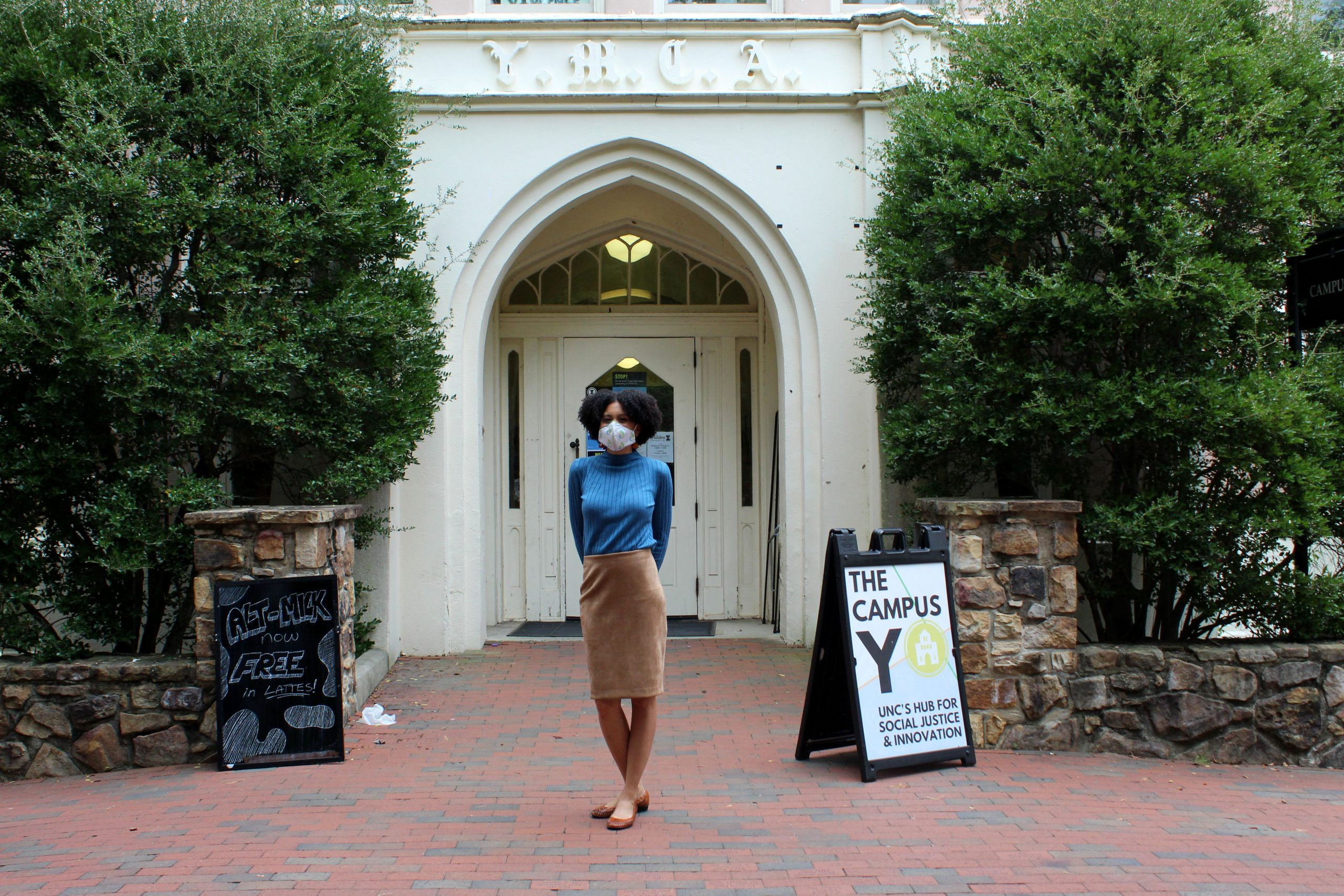 Yalitza Ramos poses for a photograph with her Campus Y mask in front of the Campus Y